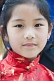 Image of A young Tibetan girl at the Mahabodhi Temple, where the Buddha achieved enlightenment.