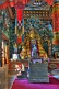 Image of Buddhist statue in colorful robes at the Bhutanese Temple.