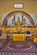 Image of Gold-robed Buddha statue on the altar of the Chinese Buddhist Monastery at Sarnath.