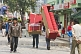 Image of Porters carry a three-piece suite of furniture along the pedestrianised M.G. Marg.