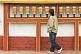 Image of Sikkimese man rotates prayer wheels at a Buddhist monastery.
