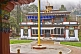 Image of Flagpole and frontage of a Buddhist monastery.