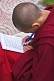 Image of Young Buddhist monk does his homework at the Rumtek Monastery.