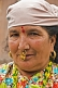 Image of Sikkimese hill-lady with gold nose-jewellry.