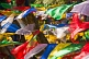 Image of Colorful Buddhist prayer flags dance in the wind at the Mahakala Temple on Observatory Hill.