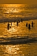 Image of Bathers in the Arabian Sea at sunset.