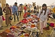 Image of Trinket sellers display their wares to pilgrims under Lal Bahadur Shastri Bridge.