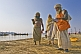 Image of Three Hindu holy men at the Ganges Yamuna river Sangam.