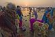 Image of Women pilgrims prepare for ritual bathing in Ganges river at dawn.