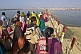 Image of Indian Hindu pilgrims cross pontoon bridge over the River Ganges at the Kumbh Mela.