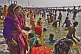 Crowds of Hindu pilgrims bathe in Ganges river shallows on Basant Panchami Snana.