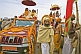 Image of Decorated trucks and Holy Men at Basant Panchami Snana Procession.