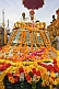 Image of Two Holy Men on roof of flower decorated jeep for Kumbh Mela procession.
