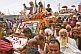 Image of Mass crowds of Hindu Holy Men and jeeps block the Kumbh Mela procession road.