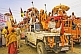 Highly decorated jeeps with Hindu Sadhus in Basant Panchami Snana procession.