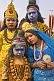 Image of Four Indian children in colorful clothes and face paint decorated as Hindu Gods.