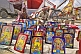 Collection of framed religious Hindu paintings for sale at Kumbh Mela festival.