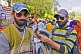 Two young men sell false beards and moustaches to Kumbh Mela pilgrim visitors.