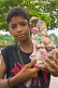 Small Boy Holds A Statue Of Lakshmi, Wife Of Vishnu And Goddess Of Wealth, That Was Found In The River Mud
