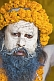 Image of Juna Akhara Naga with Vibhuti sacred ash covered face and marigold flower garlands.