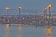 Image of Mass Hindu pilgrims at crowded Ganges Yamuna bathing ghats at dawn.