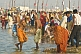 Image of Mass crowds of Hindu pilgrims bathe in the shallows of the Ganges river Sangam.