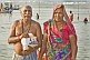 Image of Elderly Indian couple pose after taking their sacred dip in Ganges river.