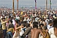 Image of Huge crowds struggle to find space to change after sacred dip in the Yamuna river.