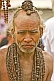 Image of Elderly Hindu Holy Man with Rudraksha bead necklaces in Kumbh Mela procession.