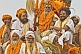 Image of Group of Hindu Holy Men decorated with marigolds on processional truck roof.