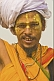 Smiling Hindu Holy Man with white turban and orange saffron robes at Kumbh Mela.