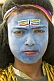 Village boy with blue Shiva face paint at Kumbh Mela Hindu festival.