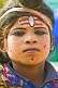 Image of Boy with Hindu God face paint raises money from Kumbh Mela pilgrim visitors.