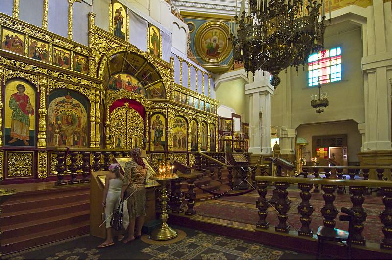 A mother and her daughter pray in the Zenkov Cathedral.