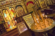 Candles and golden icon screen in the Zenkov Cathedral.