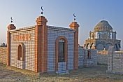 Brick-built Muslim graves and mausoleums in the early morning sunlight.