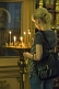 Image of Worshipper lighting candles in front of icon at Saint Nicholas Cathedral.