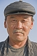 Image of Kazakh man in black leather hat.