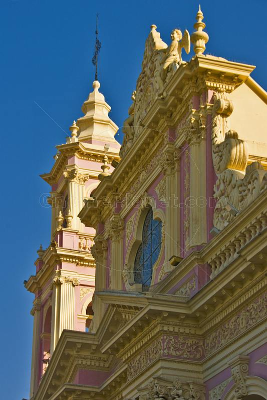 Stucco frontage and tower of Salta Cathedral.