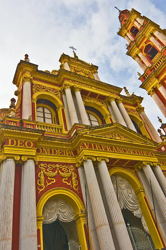 Red and gold stucco frontage of the Basilica San Fransisco.