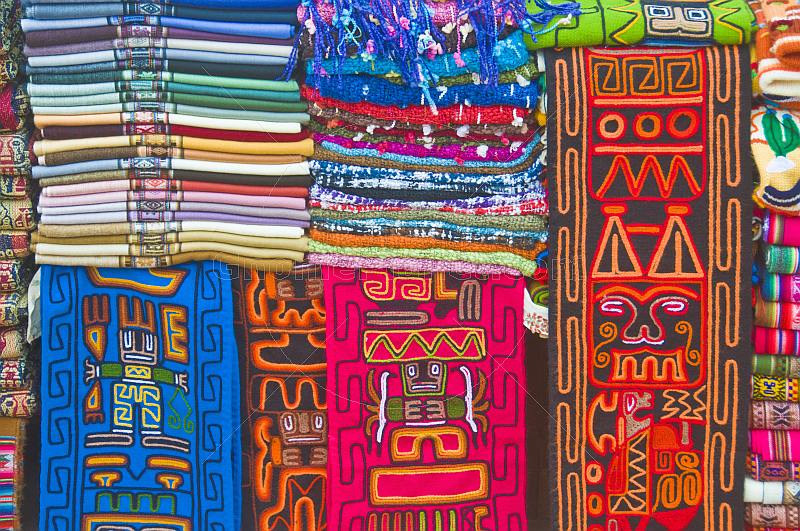 Colorful knitted and woven fabric gifts at the Purmamarca Market.
