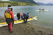Canoers prepare their kayaks for the Beagle Channel.