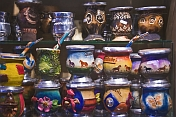 Selection of colorful pottery mate cups for sale.