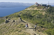 Visitors pose on the Cerro Otto overlooking Lago Nahuel Huapi.
