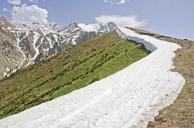 A well-defined snowline marks the Altyn Arashan Mountains in Sarycat Ertas Nature Reserve.