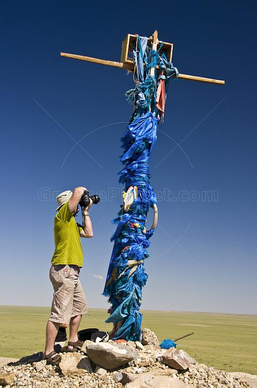 Photographing an 'Ovoo', a Mongolian Shamanistic cairn for travellers.