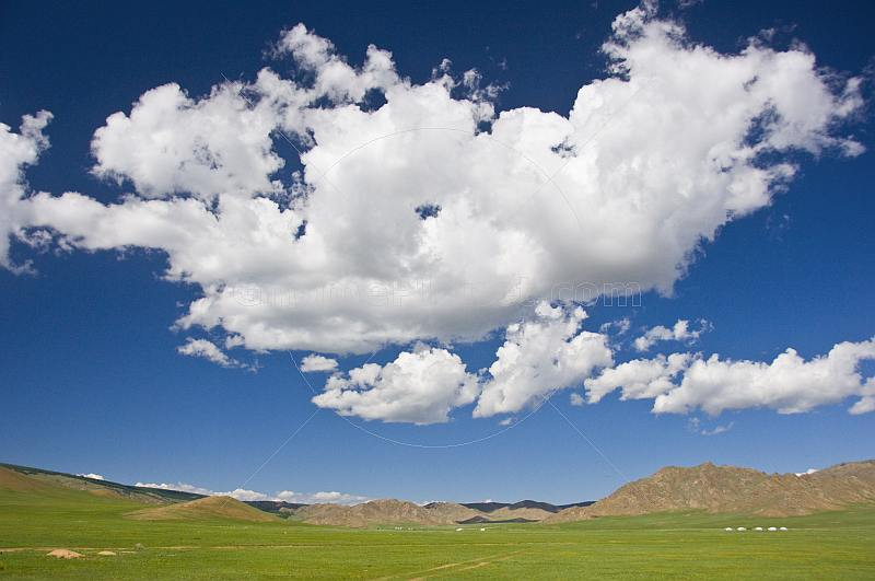 Clouds over the wide expanse of the Mongolian Plain.