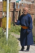 Old man with prayer wheels at the Gandan Muntsaglan Khiid monastery.
