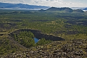 A view from the extinct Khorgo Uul volcano caldera over the rich volcanic lava fields and a crater lake.