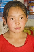 Mongolian shopkeeper's daughter, wearing a red teeshirt.